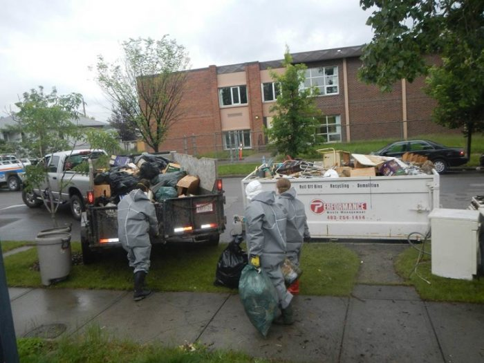 3 Mayken employees removing trash from hoarders