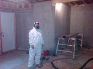 Worker At Distressed Property Restoration And Rebuild