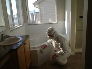Man Cleaning Blood From Trauma Cleanup - Biohazard and crime scene cleanup