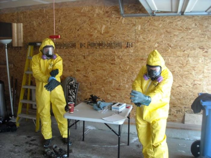 Specialists suiting up at drug house remediation
