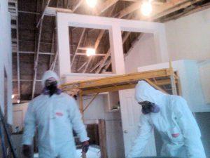 Mayken Employees Restoring Doors