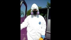 Woman Standing Infront Of Truck In White Protective Suit
