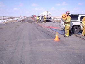 Fireman Holding Sign At Bio Hazardous Waste Removal Site