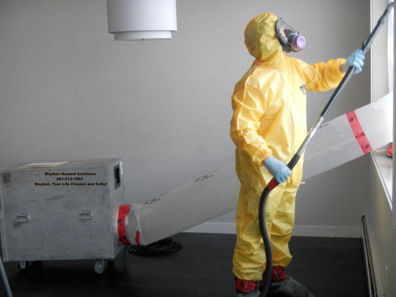 Mayken Hazmat Worker In Yellow Suit Cleaning Up Drug House