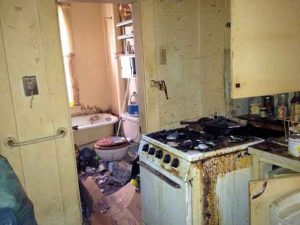 Extremely Filthy Kitchen And Bathroom Of Hoarders House Before Clean Up Services