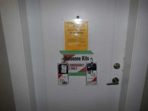 Naloxone Kit Taped To Front Of Door At Illegal Fentanyl Operation