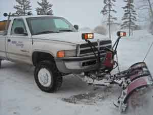 White Mayken Truck Clearing Snow As Propety Management Job