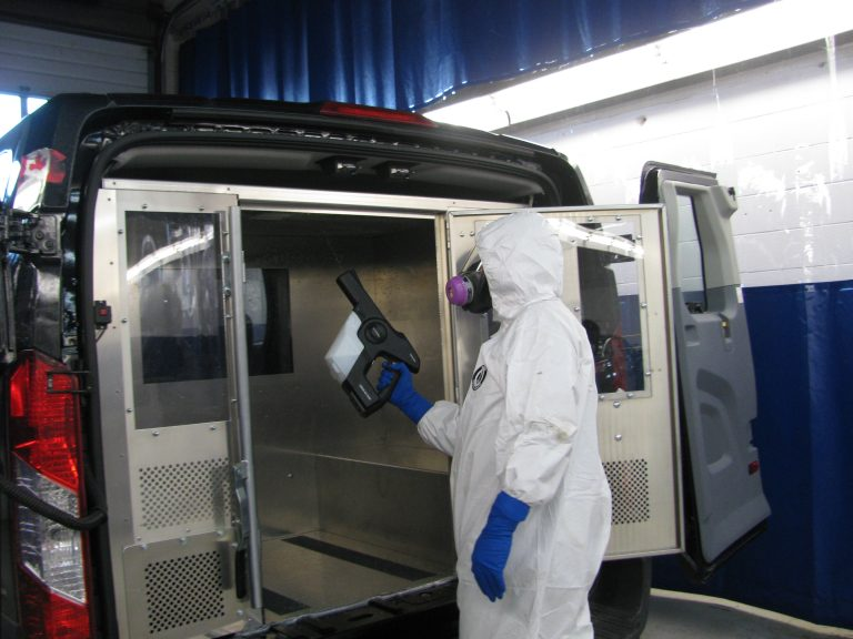 Electrostatic spraying of disinfectant inside van