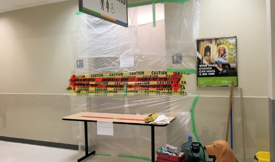Plastic and tape blocking washroom with fentanyl contamination