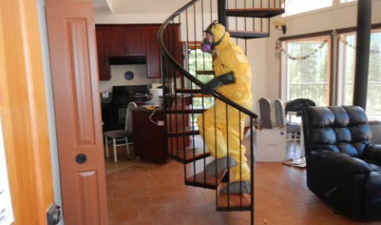 Hazmat technician on stairs in fentanyl house