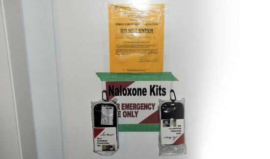 Naloxone kit taped to door at illegal fentanyl operation