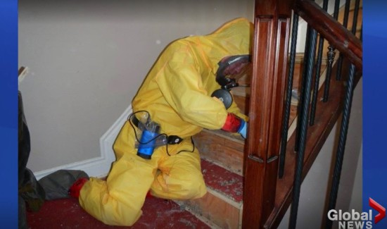 Hazmat technician in PPE cleaning stairs