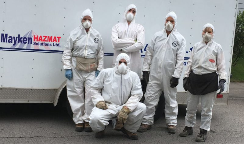 Mayken Team in protective suits and masks