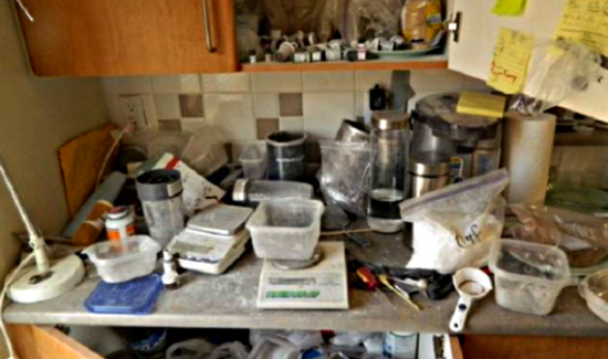 Messy kitchen with strewn drug paraphernalia