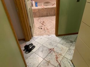 Blood streaked across hallway and bathroom floor