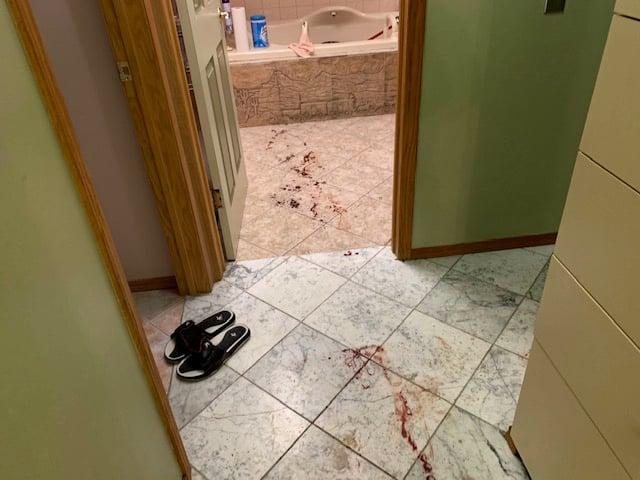 Blood streaked across hallway and bathroom floor
