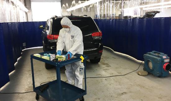 Hazmat technician testing samples from vehicle