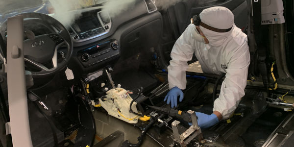 Disinfectant blowing through vehicle vents